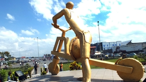 A sculpture of a man riding a tshukudu, wooden scooters used to transport goods, in the eastern Democratic Republic of Congo city of Goma.
