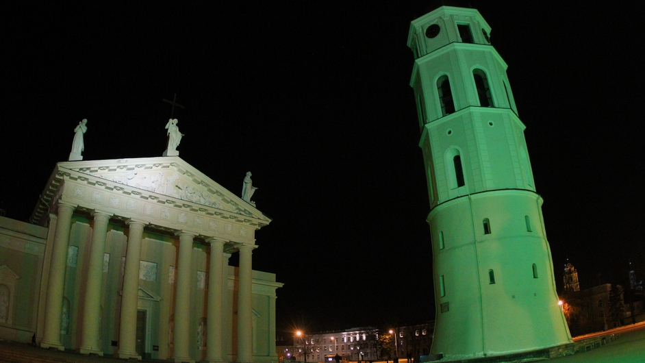 The Cathedral bell tower is illuminated green to celebrate St Patrick's Day in Vilnius, Lithuania