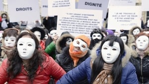 People attend a gathering by French NGO 'Medecins du Monde' to demand the abrogation of the legislation that criminalized public solicitation in Paris