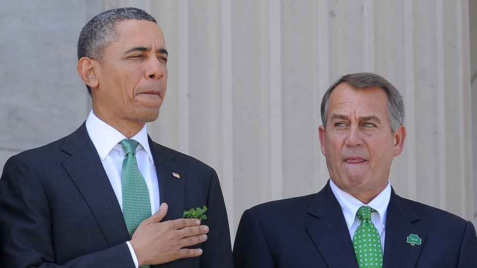 US President Barack Obama is accompanied by House Speaker John Boehner as he leaves the US Capitol after attending a St Patrick's Day lunch along with Taoiseach Enda Kenny