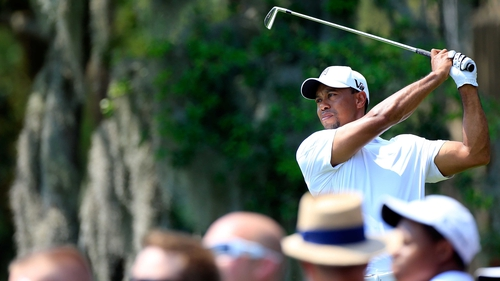 Tiger Woods plays a shot on the fith hole during the third round of the Arnold Palmer Invitational
