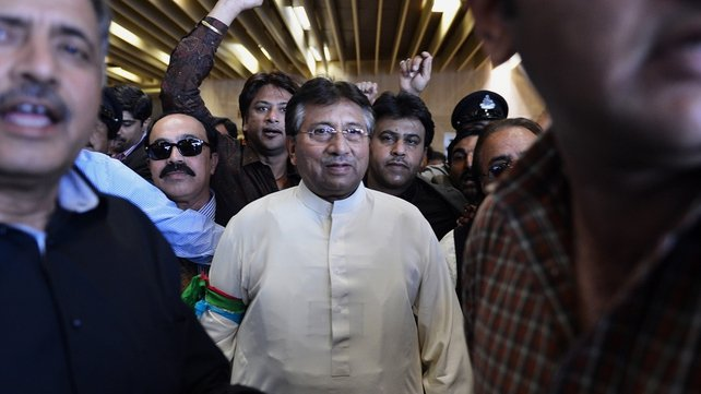 Pervez Musharraf was met by supporters on his arrival back in  Pakistan after four years in exile
