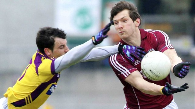 Graeme Molloy of Wexford tackles Galway's Michael Meehan