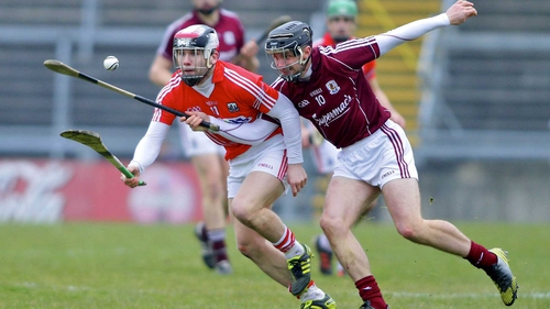 Cork's Paudie O'Sullivan and Galway's Aidan Harte vie for possession at Pearse Stadium