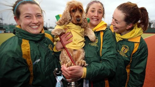 Railway Union players Isobel Joyce, Emma Smyth and Kate McKenna celebrate their with Electric Ireland Irish Senior Cup success with Lolo the dog