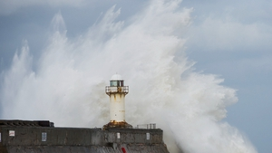 Huge waves crash against the South Gare lighthouse in South Gare, Teesside, England