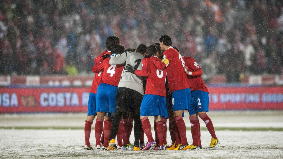 Costa Rica's players enter a huddle, possibly for warmth as much as anything else, at Dick's Sporting Goods Park