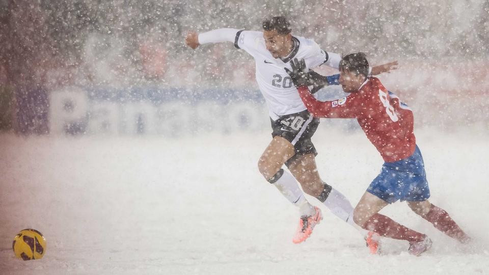 Costa Rica's Bryan Oviedo lunges at US star Geoff Cameron