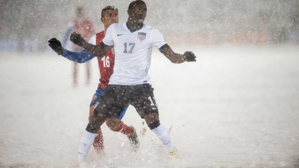 Jozy Altidore of the United States and Costa Rica's Diego Calvo battle for possession in dire conditions in Commerce City, Colorado