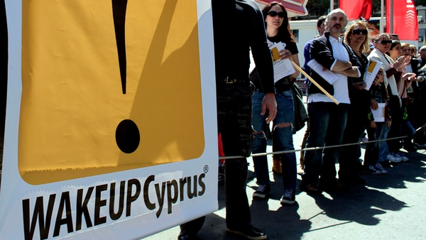 European leaders said the deal averted a chaotic national bankruptcy that might have forced Cyprus out of the euro