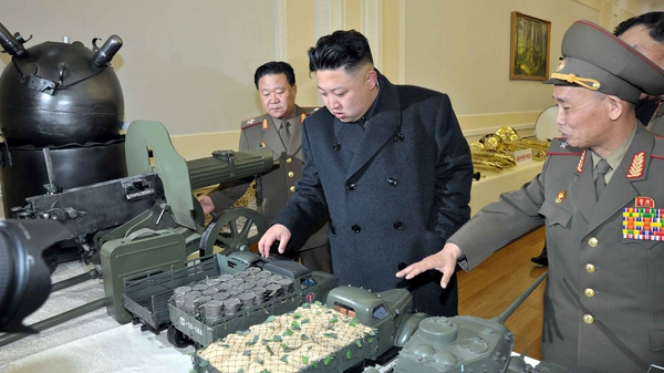 North Korean leader Kim Jong-Un inspects model military vehicles in a photo released this week