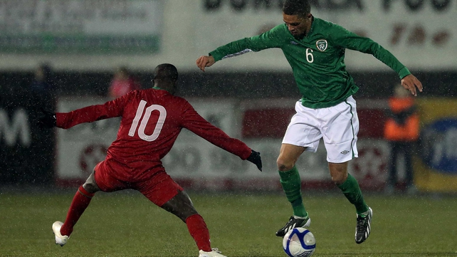 The Republic of Ireland's Kane Ferdinand takes on Portugal's  Francisco Junior