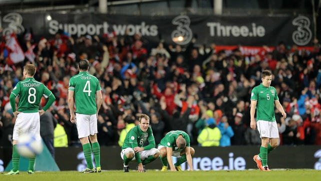Irish players show their disappointment at the final whistle