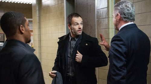 Johnny Lee Miller (centre) leads the Elementary cast as a latterday Sherlock Holmes