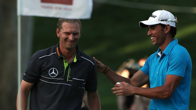 Marcel Siem of Germany is congratulated by Rafa Cabrera-Bello after holing his bunker shot on the 18th hole at the Hassan II Trophy in Morocco