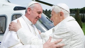 Pope Emeritus Benedict greets Pope Francis at the papal residence in Castel Gandolfo