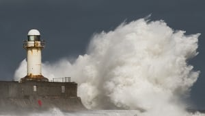 Huge waves crash against the South Gare lighthouse in Teesside, England