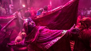 A Hindu devotee dances during Lathmaar Holi celebrations in the village of Barsana, near Mathura, India