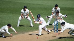 Ian Bell of England is surrounded by New Zealand fielders as he defends his wicket during day five of the Third Test match between New Zealand and England