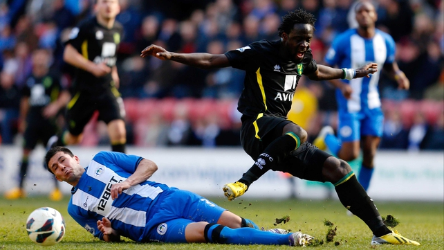 Wigan's Antolin Alcaraz slides in on Kei Kamara