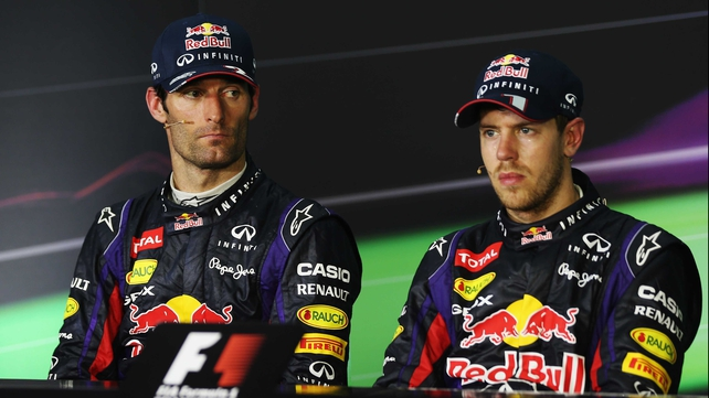 If looks could kill - Mark Webber (L) and Sebastian Vettel at the post-race press conference