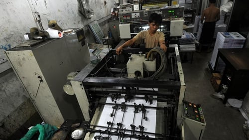 An employee monitoring the printing of newspapers at a printing house in Yangon last month