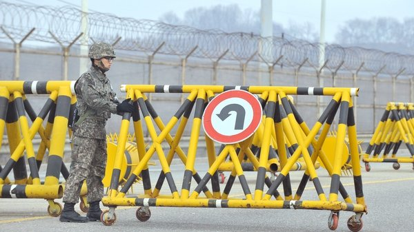 A South Korean soldier sets up a barricade in the demilitarised zone on the border