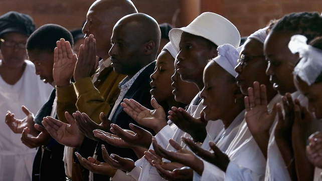 People pray for Nelson Mandela at Easter services in Soweto, South Africa