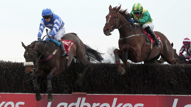 Liberty Counsel (left) jumps clear of Away We Go en route to landing the Irish Grand National