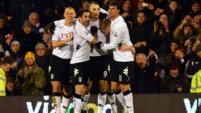 Dimitar Berbatov celebrates scoring Fulham's opener with his team-mates at Craven Cottage