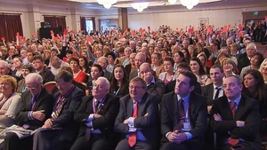 Delegates at Irish National Teachers' Organisation conference held up red cards for Minister Ruairi Quinn