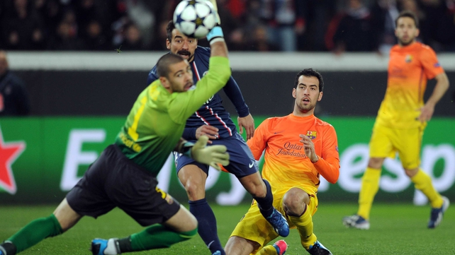 Barcelona goalkeeper Victor Valdes watches as Paris Saint-Germain's Argentine forward Ezequiel Lavezzi's effort hits the wordwork