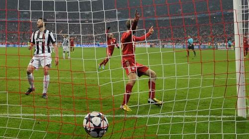 Bayern Munich's striker Thomas Mueller scores the second goal