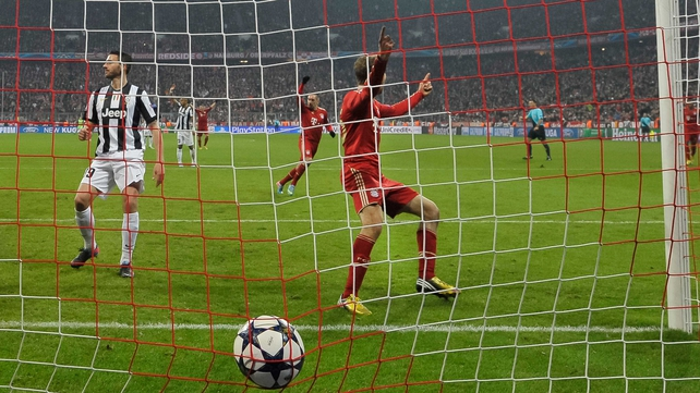 Bayern Munich's striker Thomas Mueller scores the second goal