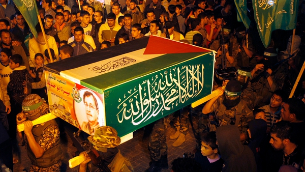 Palestinian Hamas militants hold a symbolic coffin for Maysara Abu Hamdeya during a protest yesterday