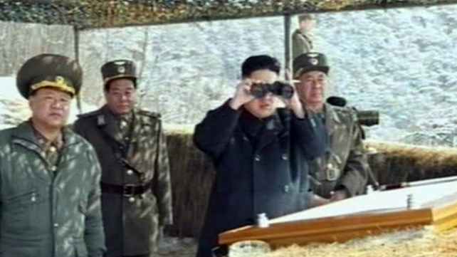 Video grab taken from North Korean TV on 20 March shows North Korean leader Kim Jong-Un's overseeing a live fire military drill