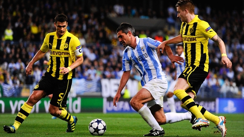 Jeremy Toulalan of Malaga CF duels for the ball with Sebastian Kehl (L) and Marco Reus