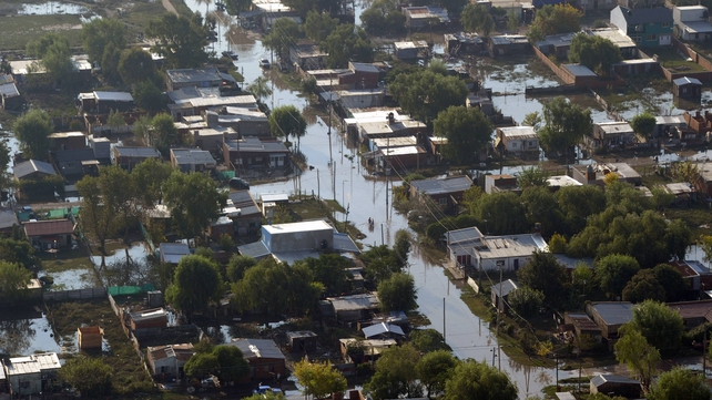 Days of torrential rains swamped Argentina's low-lying capital
