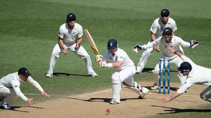 England's Ian Bell is surrounded by New Zealand fielders as he defends his wicket during their Test match