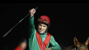 Joel Rosario on Animal Kingdom celebrates after winning the $10 million Dubai World Cup, the world's richest race.