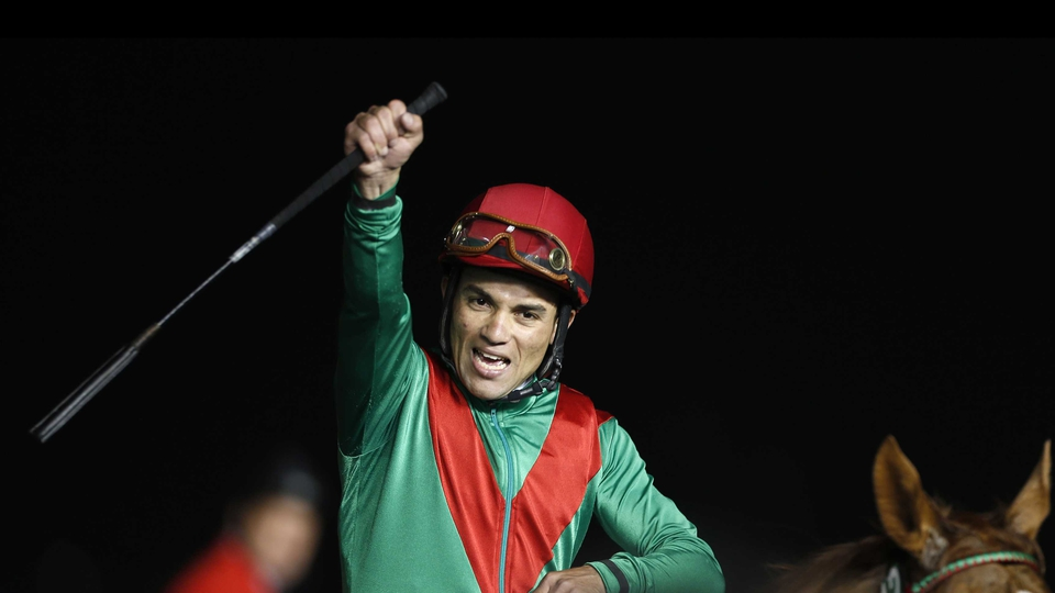 Joel Rosario on Animal Kingdom celebrates after winning the $10 million Dubai World Cup, the world's richest race.