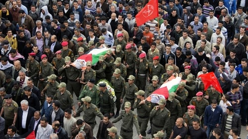Palestinian honour guards carry the bodies of Amer Nasser and Naji Balbisi through Anabta