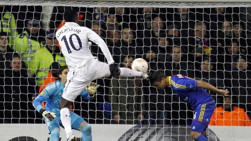 Emmanuel Adebayor fires home the first goal for Tottenham