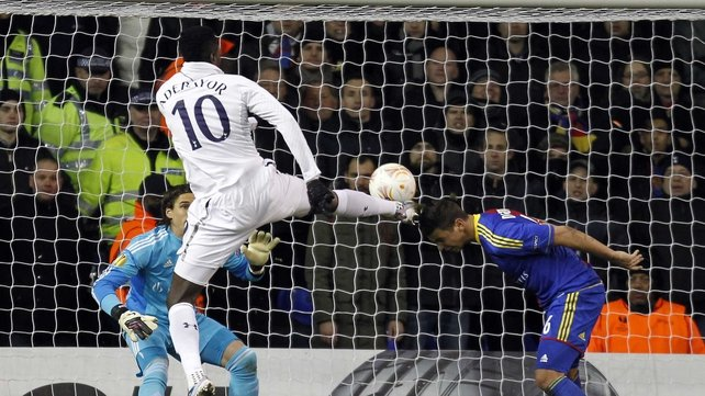 Emmanuel Adebayor fires home the first goal for Tottenham