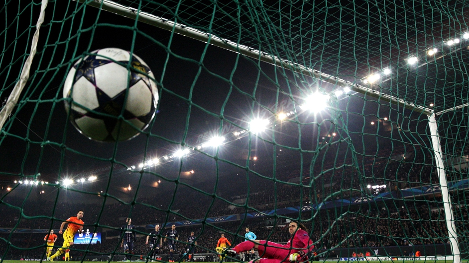 Xavi Hernandez scores a penalty for Barcelona in their Champions League quarter-final against Paris Saint Germain