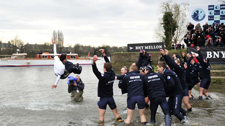 Oxford rowers throw their cox Oskar Zorrilla into the river after their victory over Cambridge in the University Boat Race