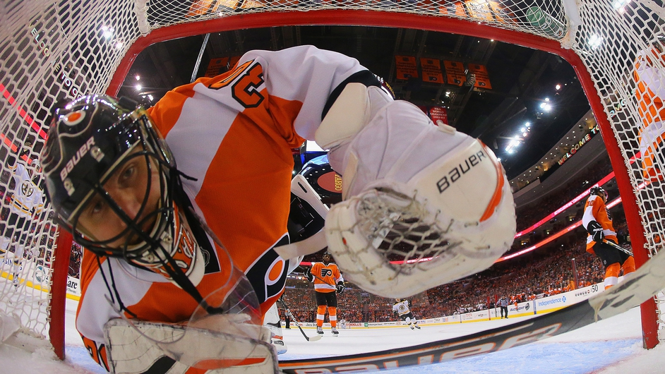 Ilya Bryzgalov of the Philadelphia Flyers looks back in the net after a goal by Nathan Horton of the Boston Bruins