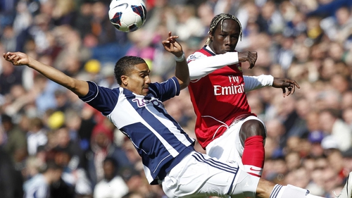 Jerome Thomas(l) tackles Arsenal defender Bacary Sagna