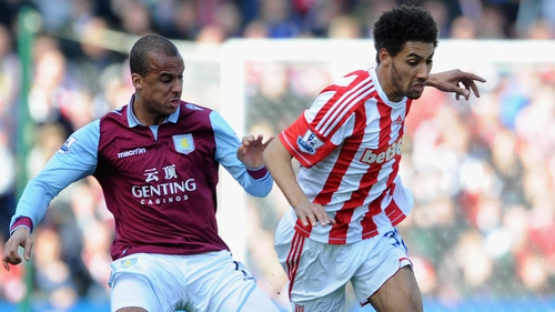 Ryan Shotton of Stoke City competes with Gabriel Agbonlahor of Aston Villa