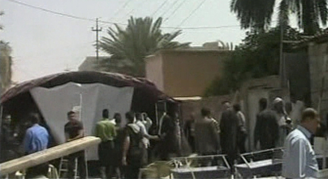 A suicide bomber killed 22 people and wounded 60 in a crowded election campaign tent